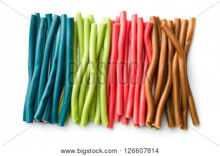 Sweet gummy sticks with different flavor. Tasty candies isolated on white background.