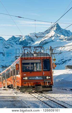 ZERMATT, SWITZERLAND - FEBRUARY 05, 2016: A Gornergratbahn train arriving at the summit station above Zermatt in Switzerland