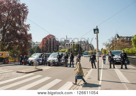 STRASBOURG FRANCE - APR 20 2016: Police blocking street as hundreds of people demonstrate as part of nationwide day of protest against proposed labor reforms by Socialist Government