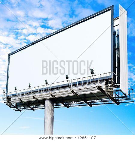 Billboard over cloudy sky
