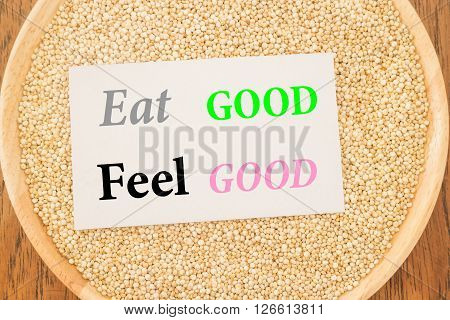 Eat good feel good quote on quinoa and business card stock photo