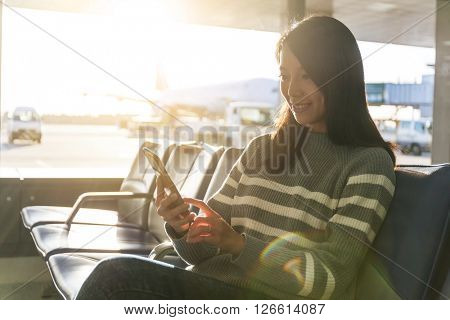 Woman chat on cellphone at airport