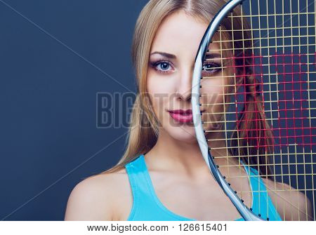 woman with a tennis racket, isolated against white studio background
