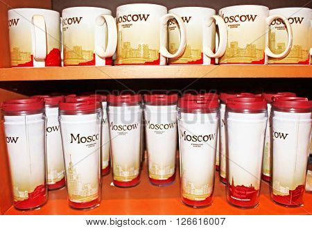 MOSCOW, RUSSIA - JUNE 0,5 2013: Starbucks mugs in Moscow Starbuck,s Russia. Starbucks Corporation is an American global coffee company and coffeehouse chain based in Seattle, Washington