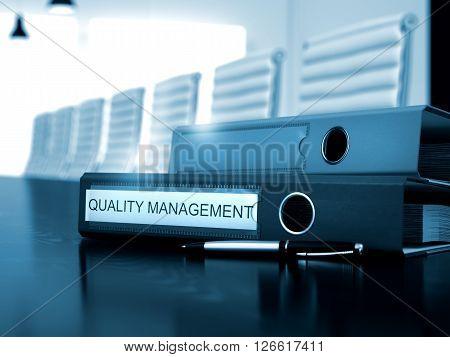 Quality Management - Folder on Wooden Desktop. File Folder with Inscription Quality Management on Black Working Desktop. Toned Image. 3D Rendering.