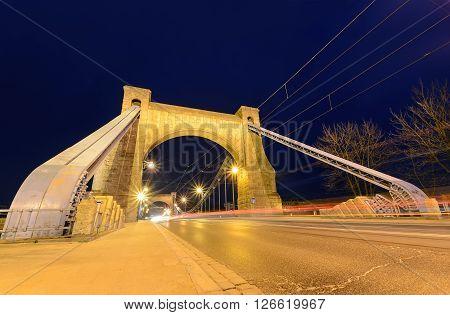 Wroclaw most famous bridge at dusk - with red auto trails. Grunwaldzki Bridge. Poland.