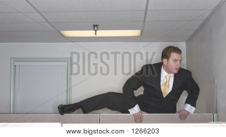 Businessman Climbs Up Over The Cubicle