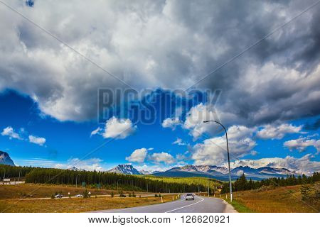 The magnificent Canadian highway among evergreen forests and snow mountains