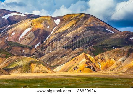 National park Landmannalaugar. Multi-color rhyolitic mountains are lit with the July sun. Travel to Iceland in the summer