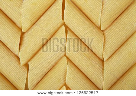 Manicotti pasta. Mostaccioli pasta. Background of italian penne traditional pasta