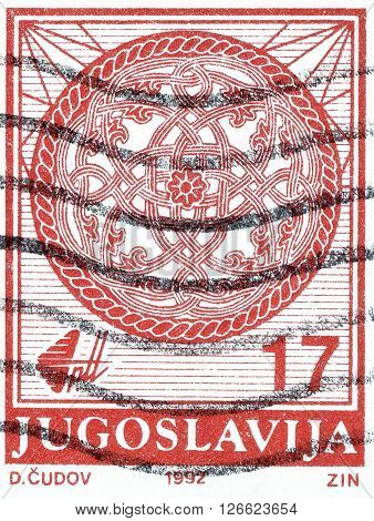 YUGOSLAVIA - CIRCA 1992 : Cancelled postage stamp printed by Yugoslavia, that shows Coat of arms.