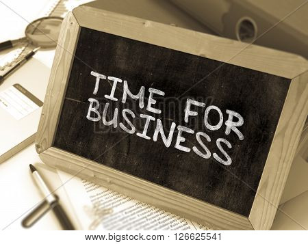 Handwritten Time for Business on a Chalkboard. Composition with Chalkboard and Ring Binders, Office Supplies, Reports on Blurred Background. Toned Image. 3D Render.
