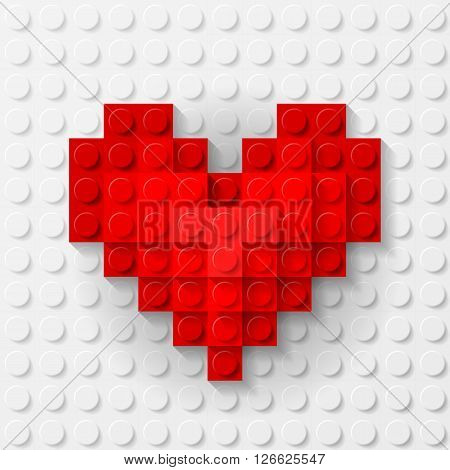 Plastic red heart on white background made of construction kit