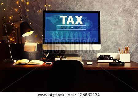 Online Tax payment concept. Comfortable workplace with modern computer