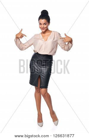 Confident business woman in full length pointing at herself, isolated on white background
