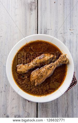 Chicken curry in a bowl / Malaysian chicken curry / indian chicken curry / Pakistani chicken curry / asian chicken curry / chicken masala, red chicken curry, spicy chicken preparation