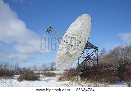 View of the antenna of the radio telescope of the Pulkovo astronomical observatory, sunny february day. St. Petersburg