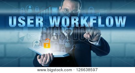 Business user touching USER WORKFLOW on a virtual interactive screen. Information technology concept and business process metaphor for the working pattern and behavioral traits of a knowledge worker.