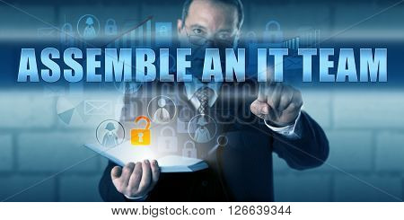 IT solutions provider pressing ASSEMBLE AN IT TEAM on a virtual visual display. Business challenge metaphor and information technology concept building an IT team as part of a disaster recovery plan.