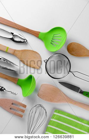 Set of stainless and wooden utensils, isolated on white
