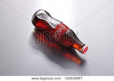 Kuala Lumpur,Malaysia -April 13 2016 high angle of coca cola bottle on the gray background