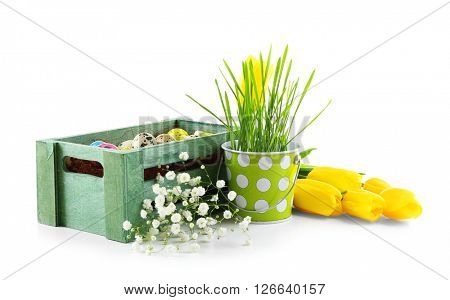 Multicoloured Easter eggs in a green crate isolated on white
