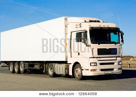 blank clean truck on blue clouded sky background