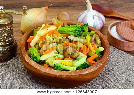 Steamed Vegetables Potatoes, Carrots, Onion and Mushrooms Studio Photo
