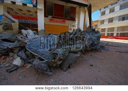 Portoviejo, Ecuador - April, 18, 2016: Collapsed car after 7.8 earthquake.