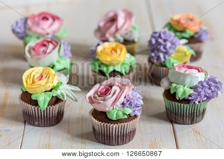 Chocolate Cupcakes With Cream-colored Flowers.