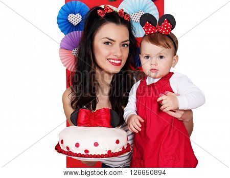 portrait of mother and daughter with cake