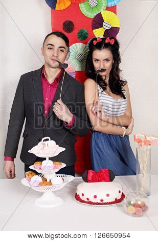 Young cheerful couple  for the holiday table