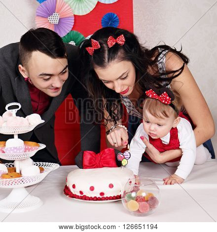 Young family celebrating the first day of the birth of daughter