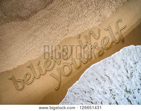 Believe in Yourself written on the beach