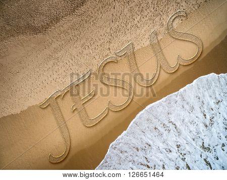 Jesus written on the beach
