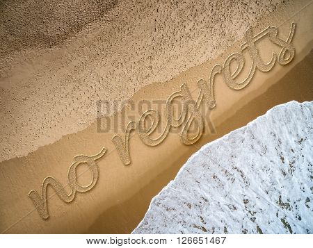 No Regrets written on the beach
