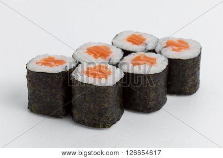 hosomaki with salmon, rice and nori on a white background