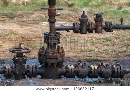 rusty oil pipes outdoor closeup