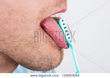 Man Cleaning Her Tongue