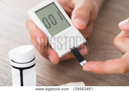 Patient Hands Measuring Glucose Level Blood Test