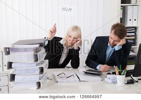 Two Businesspeople Holding White Flag With Help Text