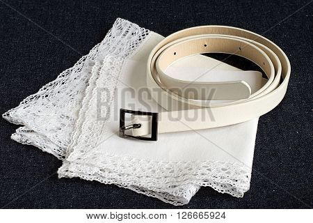 Strap and two white handkerchiefs on denim.