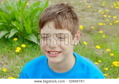 Kid And Dandelions