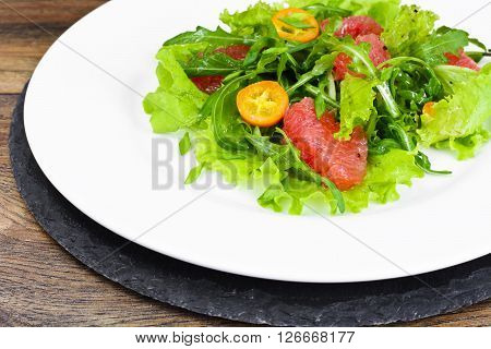 Juicy Fresh Green Salad of Lettuce, Arugula, Gapefruit and Kumquats Studio Photo