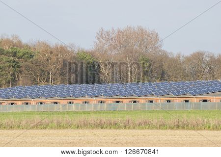 Modern barn with solar collectors on the roof