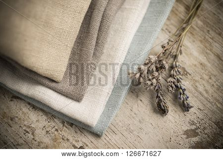 Stack Of Four Folded Dull-colored Cotton Fabric