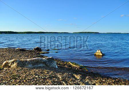 Summer sunset landscape - water area of Irtyash lake in Southern Urals Russia.