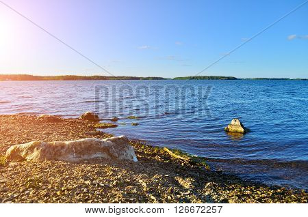 Summer water landscape - sunset over the waters of Irtyash lake in Southern Urals Russia.