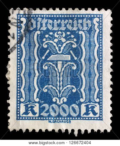 ZAGREB, CROATIA - SEPTEMBER 05: A stamp printed in Austria, shows hammer and pliers, circa 1923, on September 05, 2014, Zagreb, Croatia