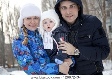 Happy couple family and her little son outdoors session winter